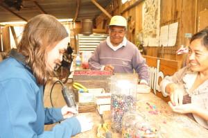 A Volunteer in Ecuador works in the artisan shop
