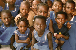 Dozen of young children looking to the camera in a Childcare Orphanage project