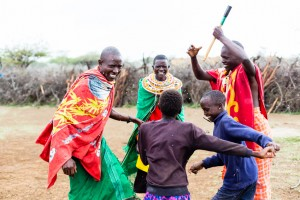 Experience the culture when you volunteer on Tanzania: Massai family celebrating and dancing