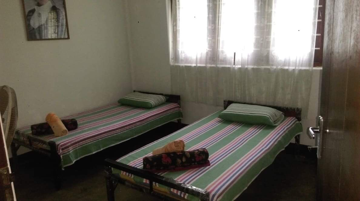 Bedroom of a homestay of our programs to volunteer in Sri Lanka
