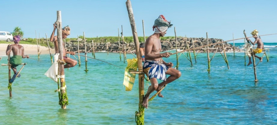 Fishermen in stilts in Sri Lanka