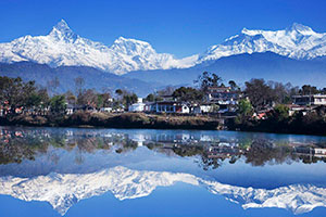 Volunteer in Nepal - Beautiful view of lake and Mount Everest overed with snow on top