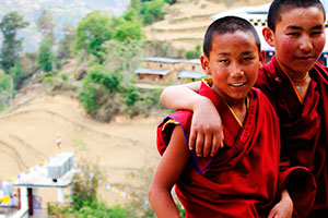 Volunteer in Nepal teaching young monks in a buddhist monastery