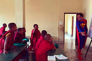 A volunteer in Nepal teaching English at a Buddhist Monastery