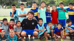Volunteer in Argentina with many children in our football project