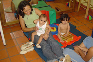 Volunteer in Argentina playing with babies in a childcare program in Argentina