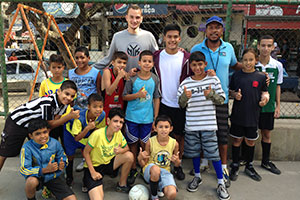 Volunteer with children in Brazil with sports - football project in Brazil