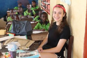 Young teacher in a classroom of a Volunteer in Ghana teaching project
