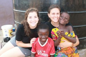 2 foreign volunteers with 2 children of the orphanage project