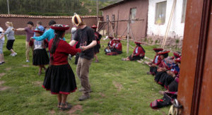 Volunteer dances with native Peruvian in our Andean Immersion program to volunteer in Peru