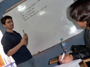 A Volunteer in Peru teaching English to teenagers
