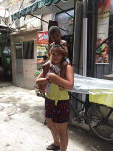 Katherine volunteering with child development