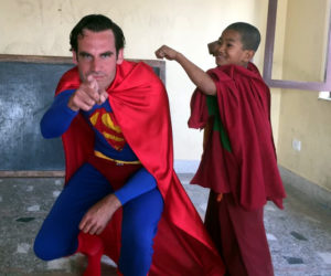 Teach English in Nepal - Lammert as Super Man with a young Monk