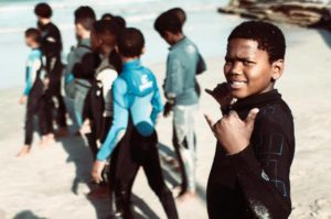 Learn to Surf and Teach Children in South Africa
