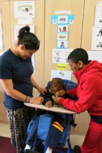 Volunteer caring for disabled children