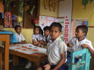 Painting with the children at the kindergarten