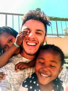 Michael Antonio with the children at Doreen